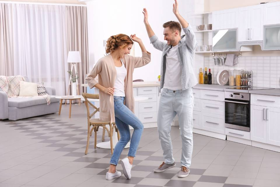 Couple is dancing in the kitchen